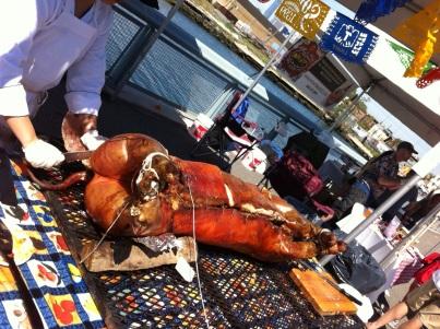 Jeanie cuts a hog for Arrogant Swine Photo credit to Shanna Gibbs